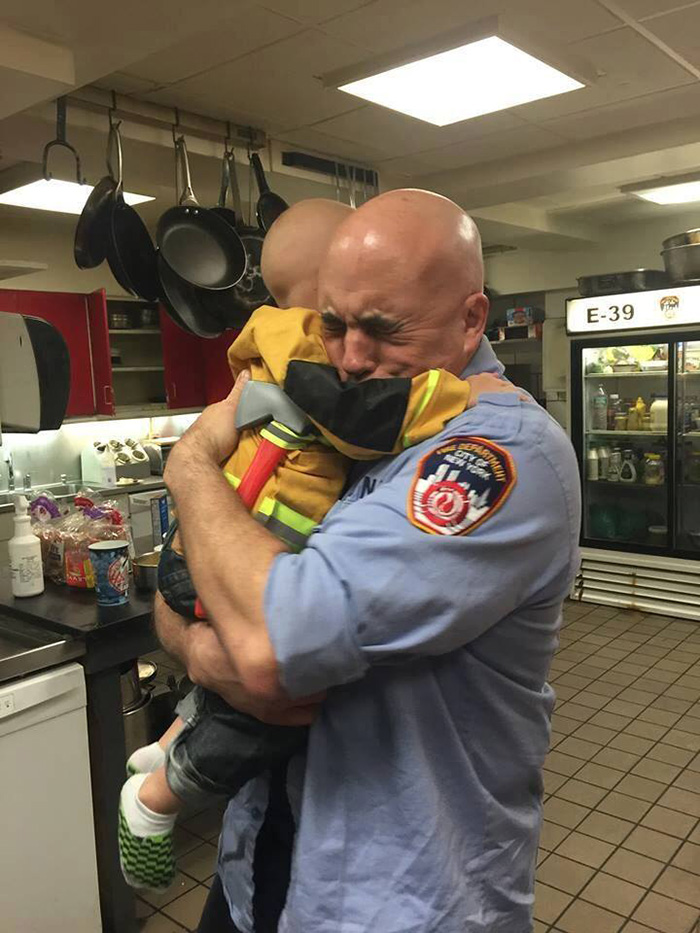 firefighter cancer boy hug photo
