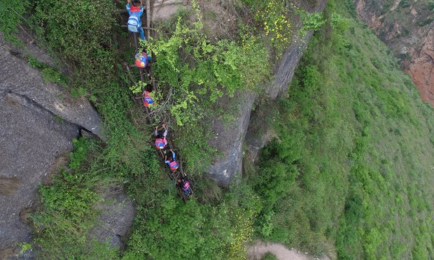 chinese students climb mountain to get to school