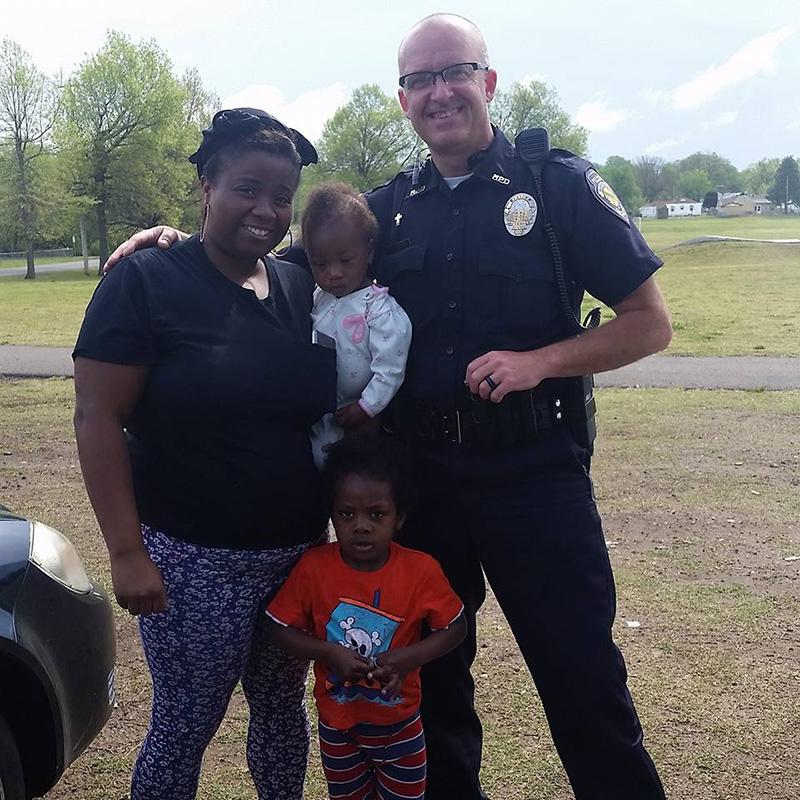 officer family little boy flower