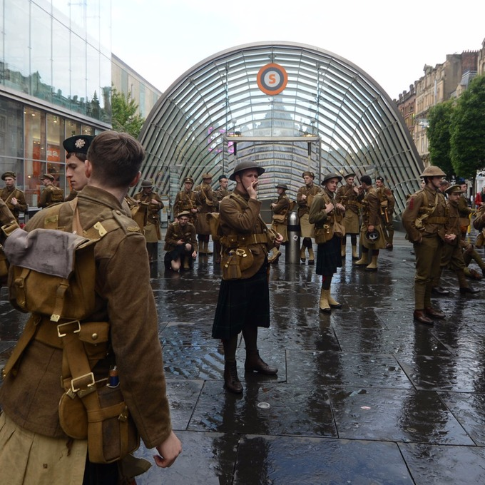 Hundreds of silent men dressed as WWI soldiers