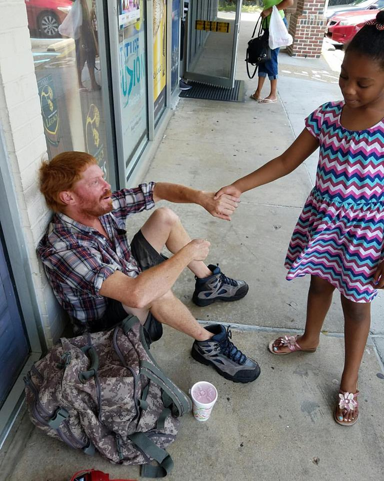 little girl homeless blind man