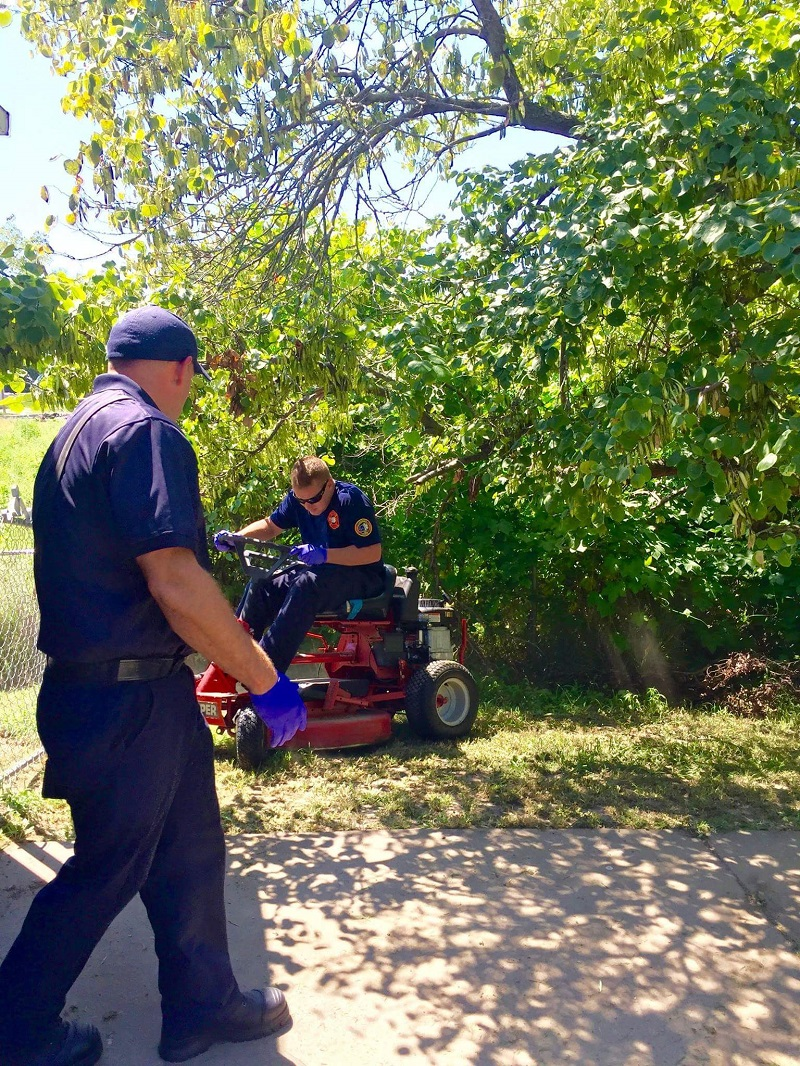 first responders stay to cut grass