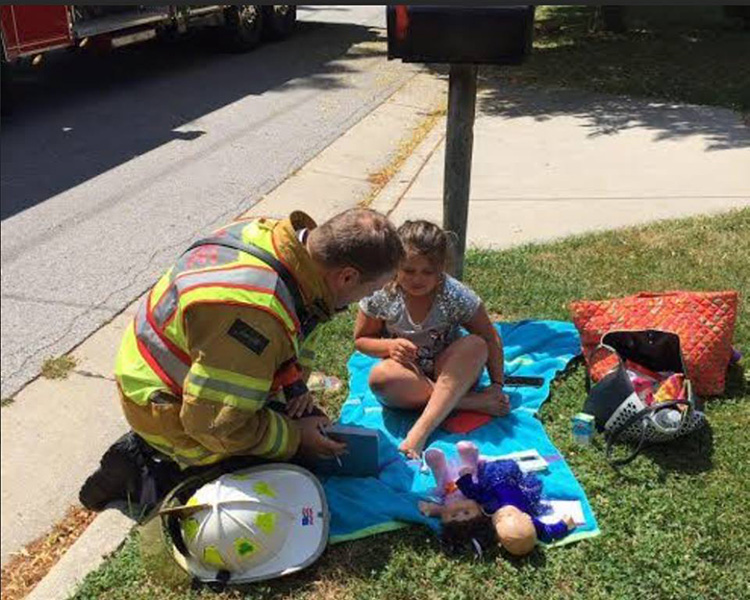firefighter distracts girl from fire happy news