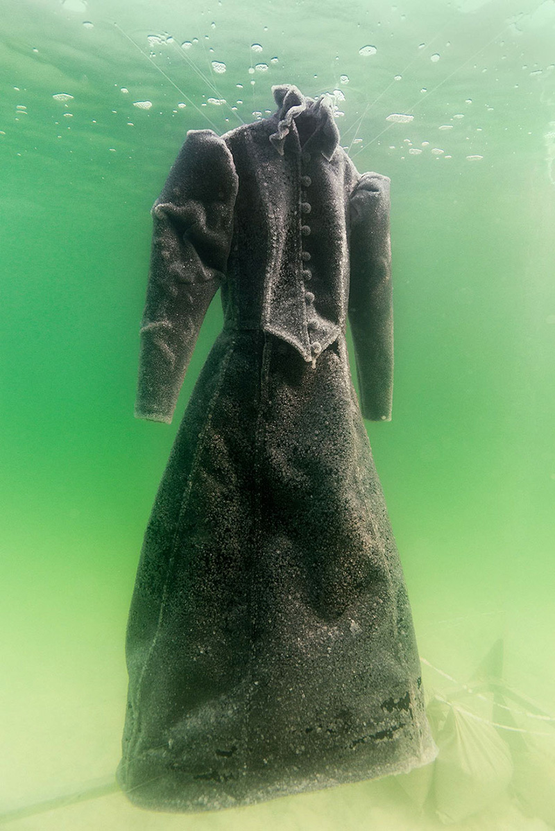 black dress in dead sea covered in salt