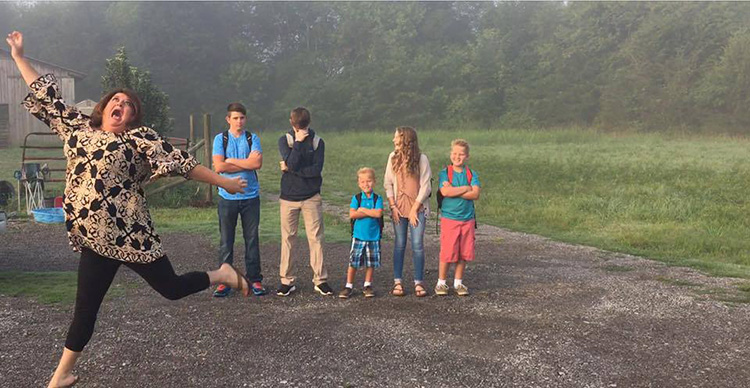 mom funny photo jumping back to school kids