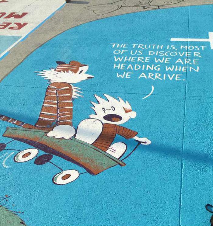 high school seniors paint parking spots