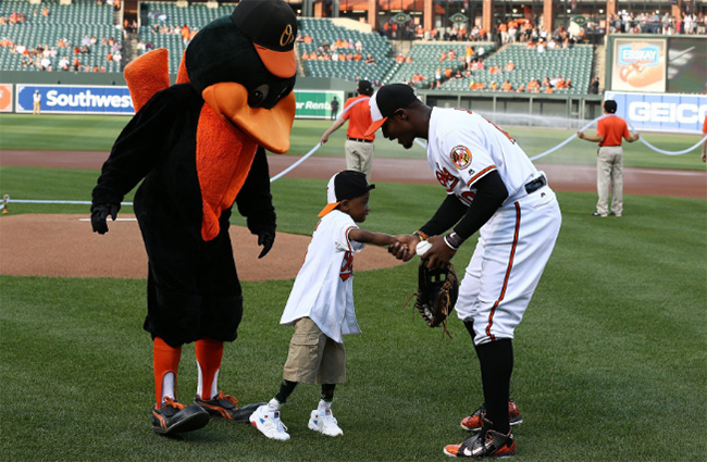 boy double hands transplant throws first pitch Orioles