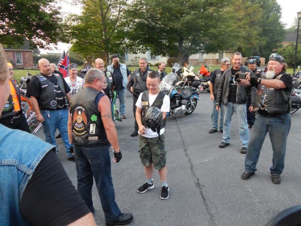 bikers escort boy with Down Syndrome to school