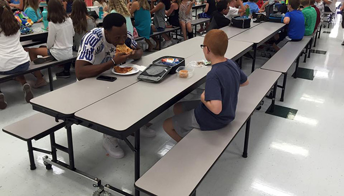 Florida State football player eats lunch with boy autism