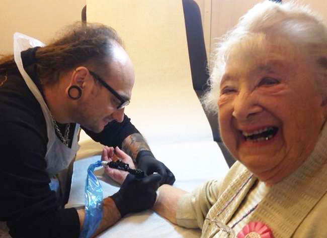 old woman first tattoo for beating cancer