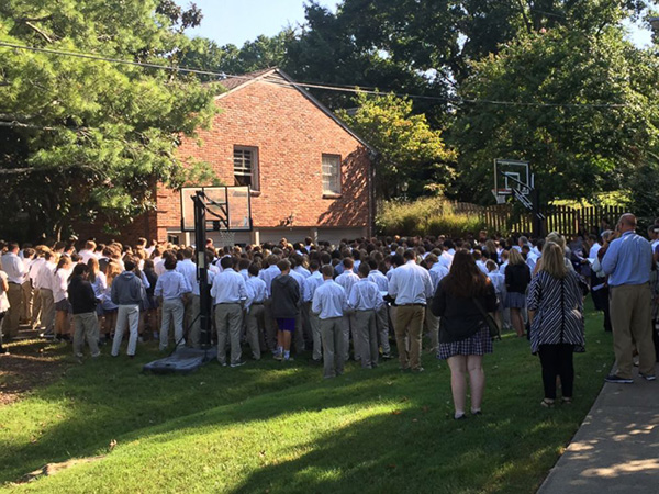 400 students sing outside teachers house