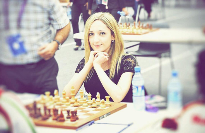 woman chess champion refuses to wear hijab in Iran
