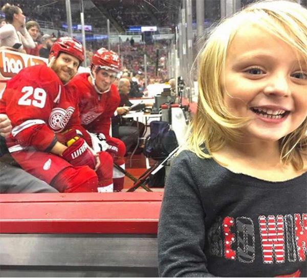 hockey players smile little girl