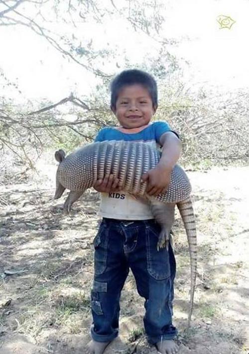 boy with pet armadillo