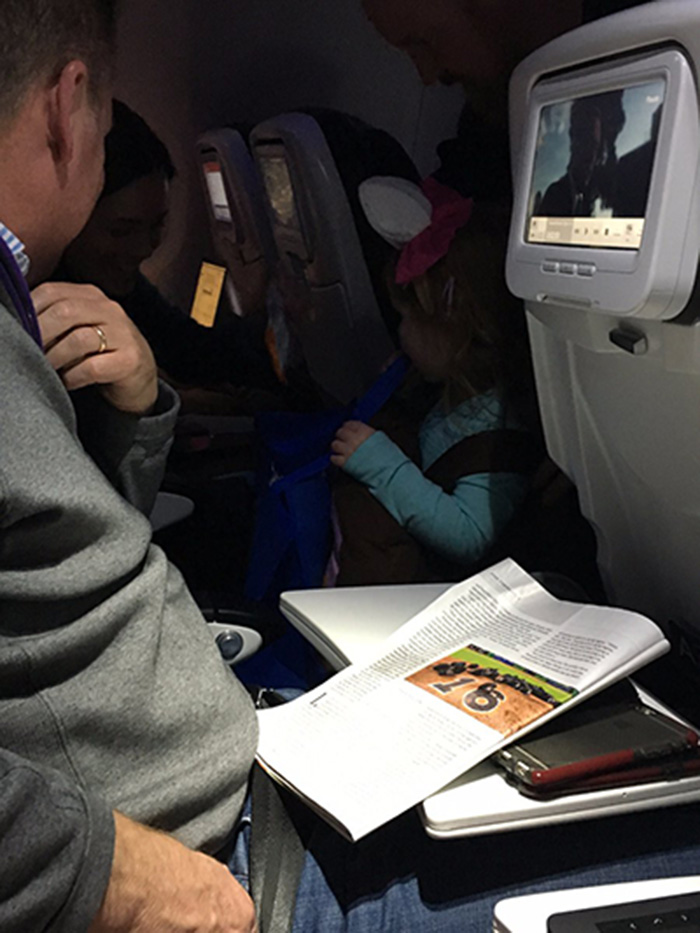 dad trick or treats on plane with daughter