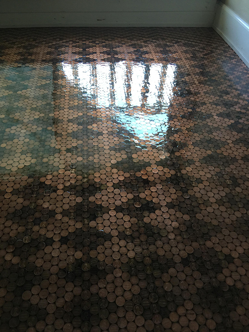 She carefully glued 13000 dark and shiny pennies to create this amazing penny floor do it yourself tutorial solutioingenieria Choice Image