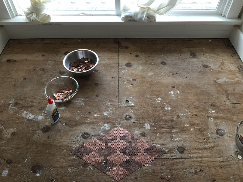 She carefully glued 13000 dark and shiny pennies to create this amazing penny floor do it yourself tutorial solutioingenieria Image collections
