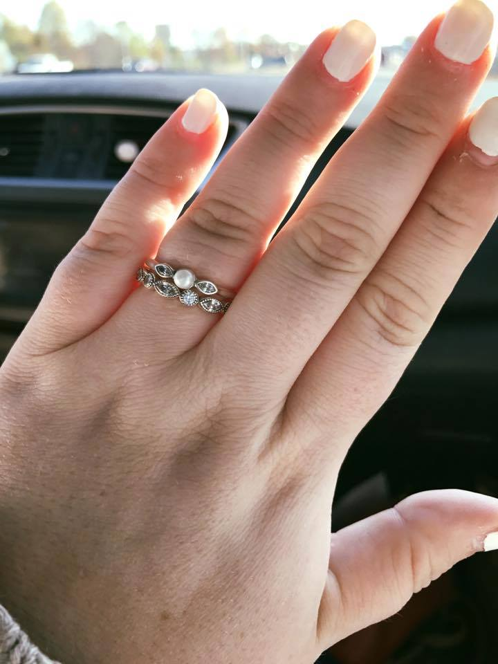 woman small engagement ring love is what matters