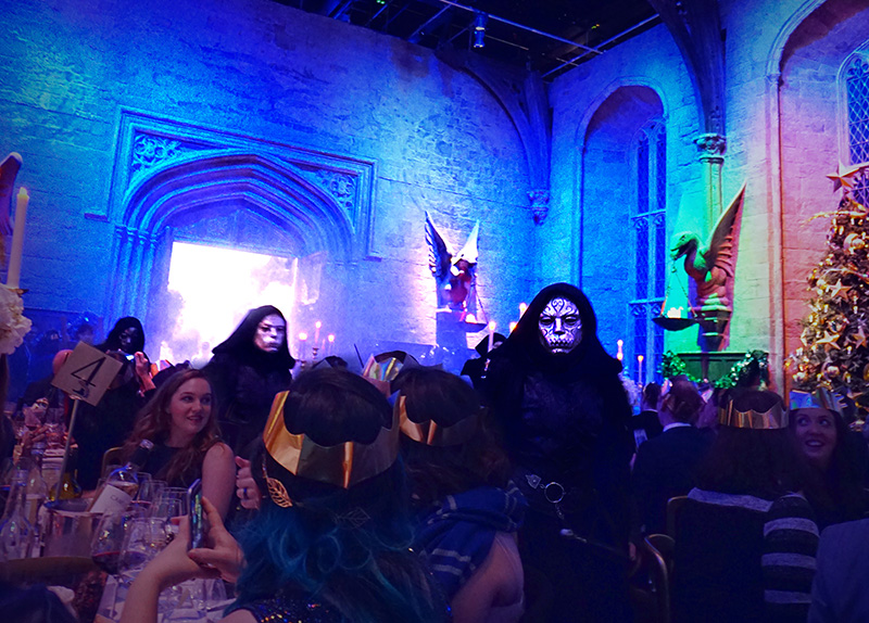 woman has dinner at great hall Hogwarts