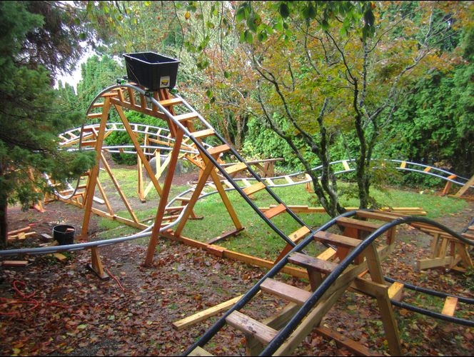 grandpa builds backyard roller coaster grandkids - Retired Grandpa Uses Free Time To Build Backyard Roller Coasters For