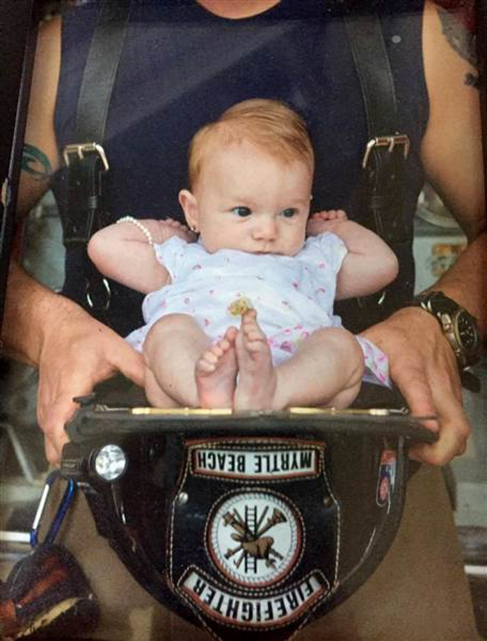 firefighter adopts baby he rescued