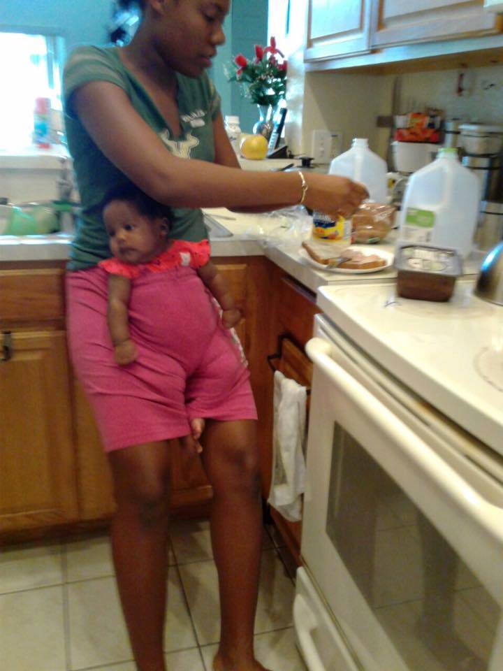 baby in shorts kitchen funny