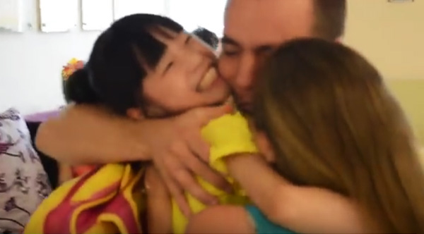 parents meet adoptive baby for the first time