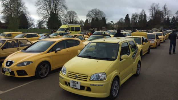 yellow cars rally for man