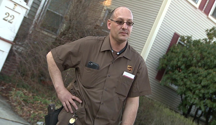 UPS driver puts out house fire saves people inside