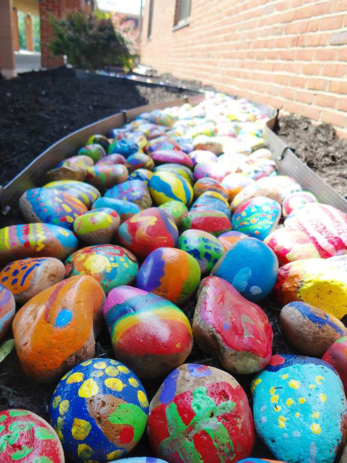 The wonderful reason every student at this school painted - Painting rocks for garden what kind of paint ...