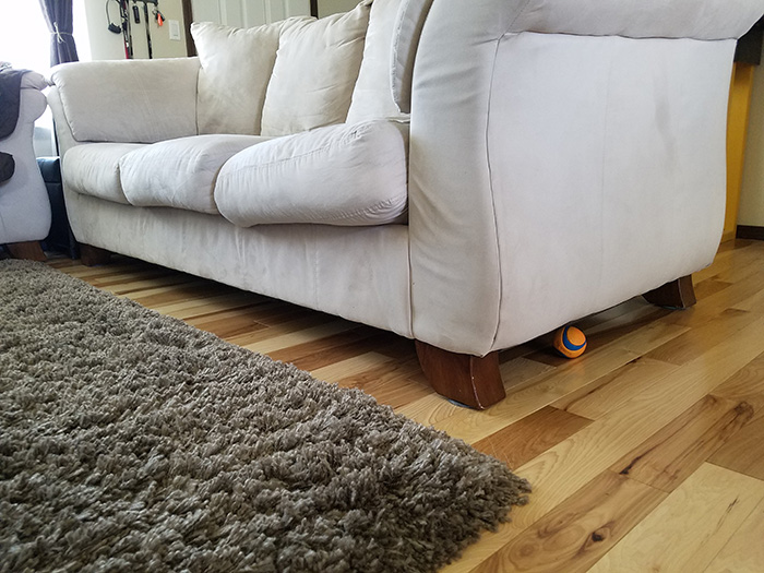 pipe insulation under couch for dog toys