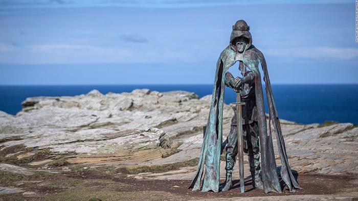 metal king arthur statue Tintagel cliffs