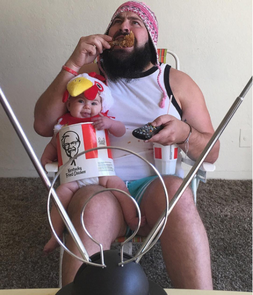 dad takes funny pictures with baby daughter