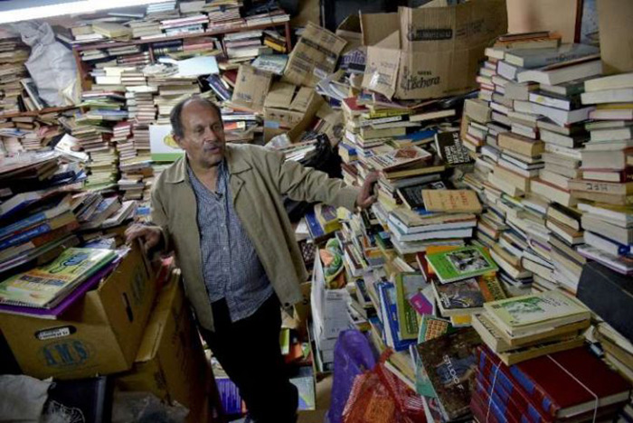 garbage man opens library with books in trash