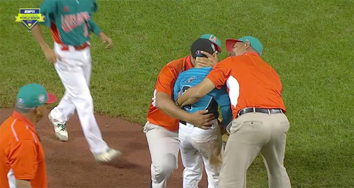 opposing coaches console pitcher after loss