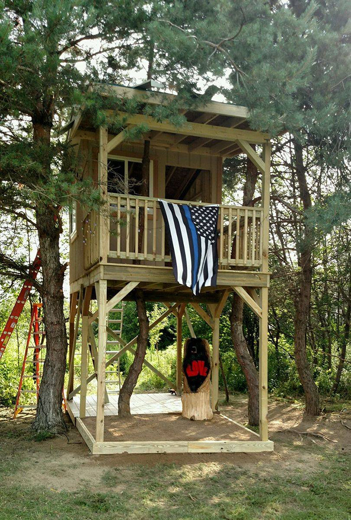 officers finish tree house slain cop