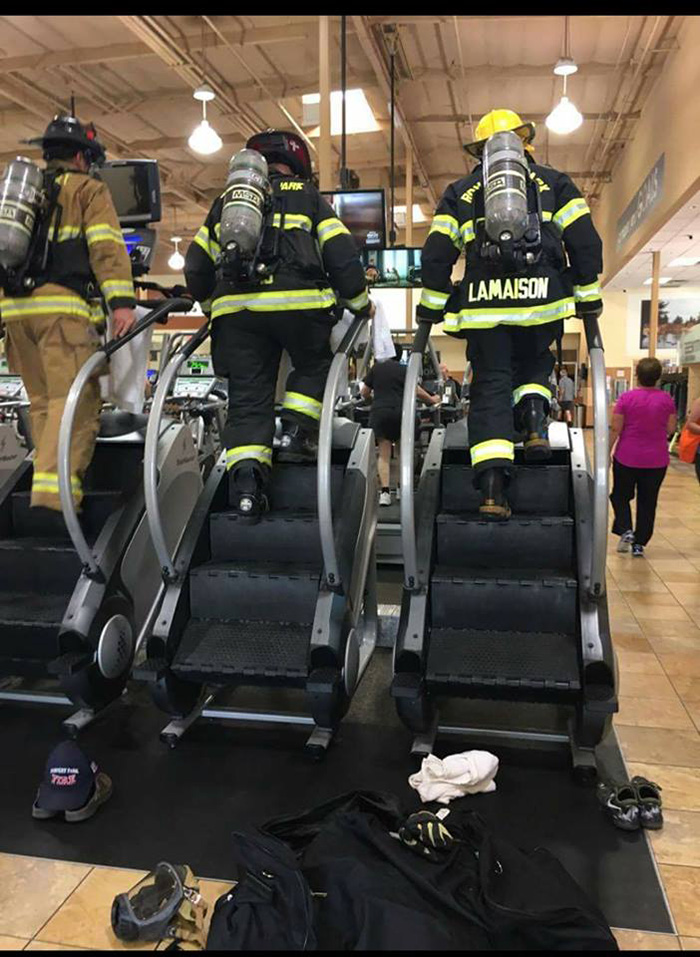 firefighters full gear climb steps in remembrance of 9 11