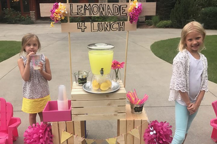little girl lemonade stand pay student lunch debt