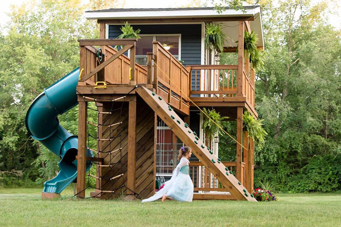 dad build epic playhouse for daughters