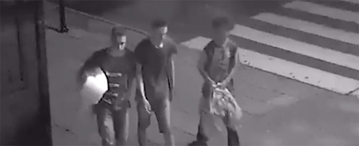 three boys help homeless man in Poland