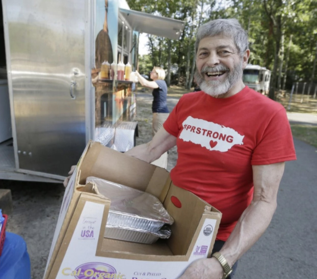 man donates food to Puerto Rico