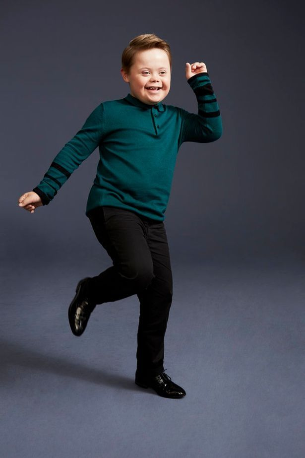 boy down syndrome model clothing store
