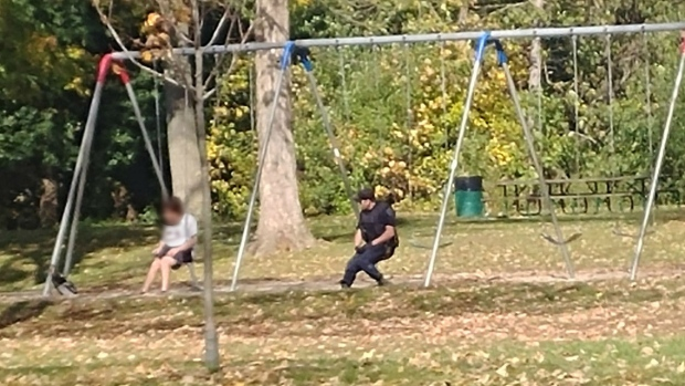 cop helps distressed man talks to him on swings