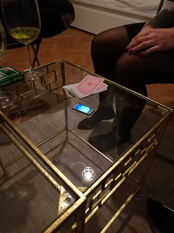 tiny iphone illusion on table