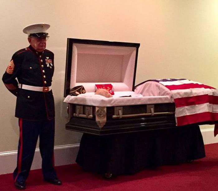 Marine stands guard funeral Vietnam vets