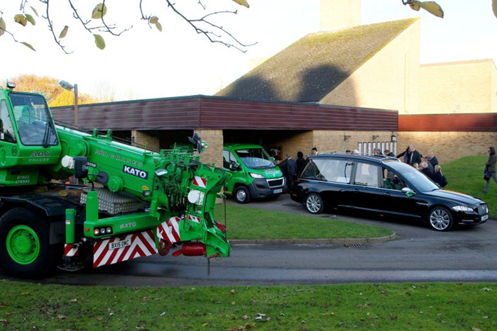 crane funeral procession for man who died