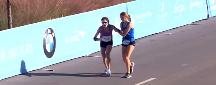 teen helps woman win marathon