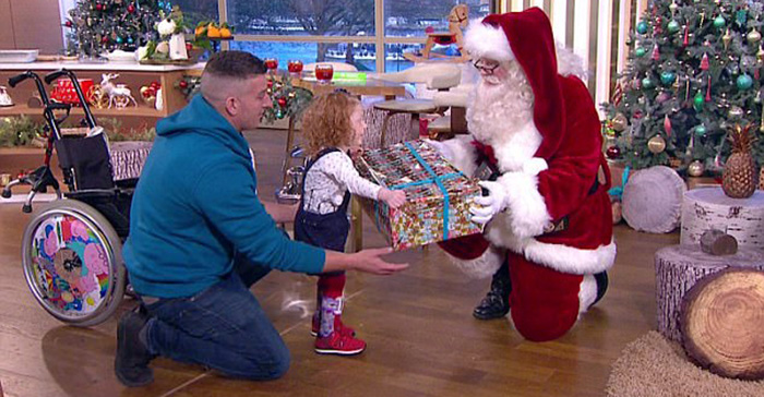 Esme Hodge walks first time to meet Santa