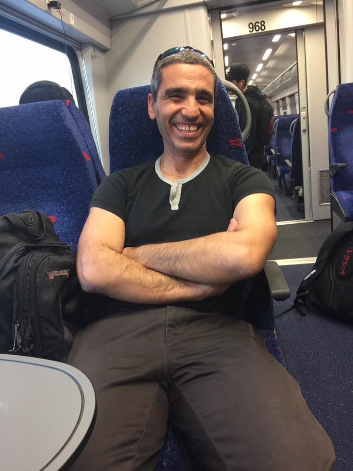 man pays womans electric bill on train
