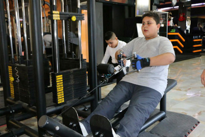 refugee boy gets free membership Turkey gym
